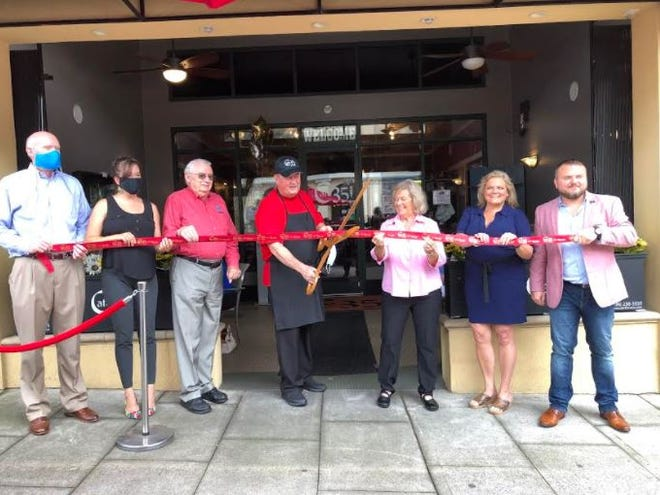 The Lexington Area Chamber of Commerce and Uptown LexingtonInc. participated in a 15-year anniversary ribbon-cutting ceremony on Aug. 13 for Café 35, 103 S. Main St. Pictured standing left to right are Lexington Chamber President Joe Wallace, Uptown Lexington Director Rebekah McGee, Davidson County Commissioner Fred McClure, owners Mark and Linda Gosselin, Jackie Gosselin and Davidson County Commissioner Zak Crotts.