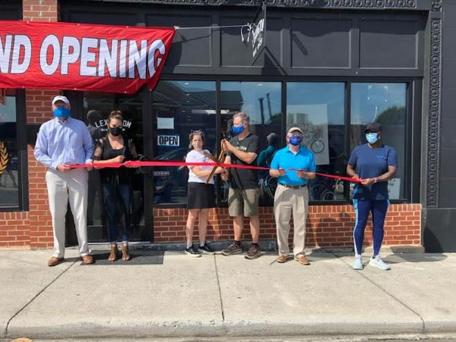 The Lexington Area Chamber of Commerce and Uptown Lexington Inc. participated in a ribbon-cutting ceremony on Aug. 1for Lexington Bike Shop, 15 E. Second St. Pictured standing left to right are Lexington Chamber President Joe Wallace, Uptown Lexington Director Rebekah McGee, owners John and Laura Slivka, Lexington Mayor Pro-tem Wayne Alley and Diane Jobe.
