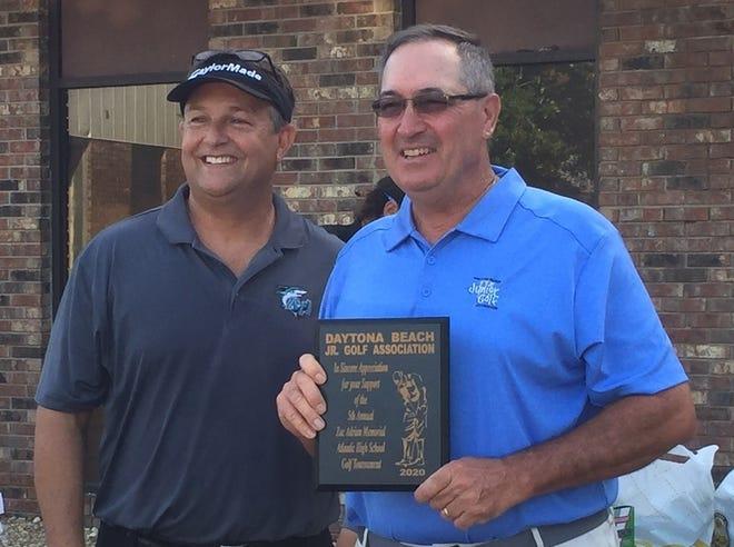 Atlantic High golf coach Rick Bowrosen presents John Cameron with a plaque to thank the D.B. Junior Golf Association.