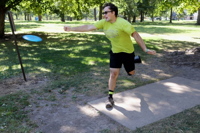 Travis Wills of West Burlington tees off while playing disc golf with a group of fiends Tuesday at Dankwardt Park in Burlington. The group which tries to get together twice a week have been playing together for the past two months. [John Lovretta/thehawkeye.com]