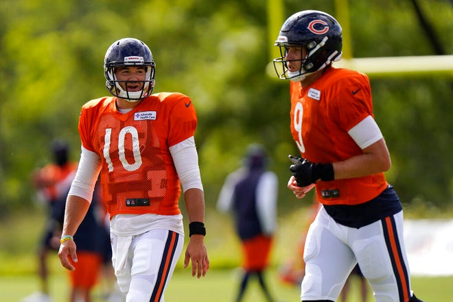 Chicago Bears quarterback Mitchell Trubisky, left, smiles as he talks to quarterback Nick Foles Tuesday during practice in Lake Forest, Illinois.