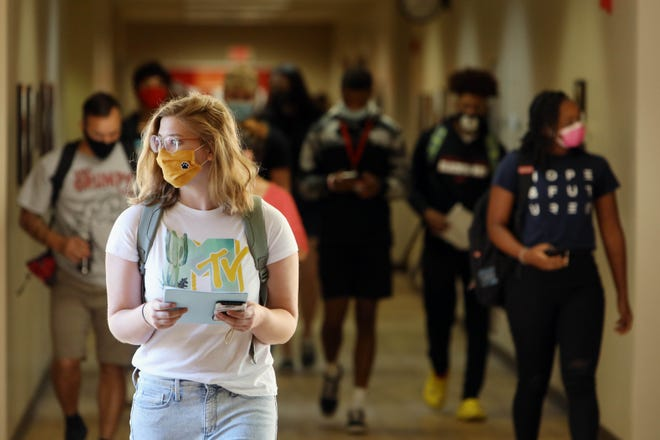 Southeastern Community College student Corinne Dengler, makes her way to the Hall of Science building for a class as students returned to campus for the first day of face-to-face classes Wednesday in West Burlington. Due to COVID-19 masks or face coverings must be worn by all SCC employees and students while in classrooms, offices, hallways and general areas within all SCC facilities.