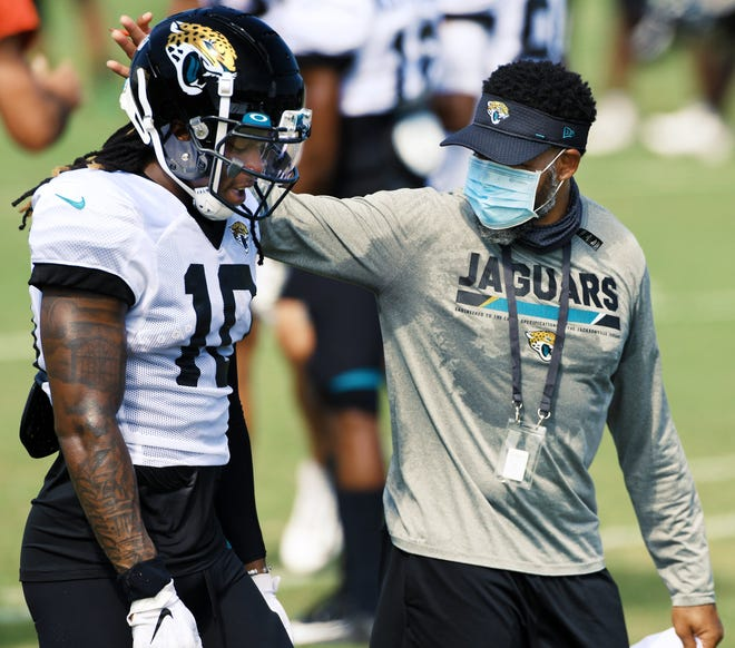 Jaguars Wide Receivers Coach Keenen McCardell talks with WR #10, Laviska Shenault Jr. after he pulled in a pass as the Jacksonville Jaguars went through drills in pads for the first time during training camp at the practice fields outside TIAA Bank Field Monday, August 17, 2020. [Bob Self/Florida Times-Union]