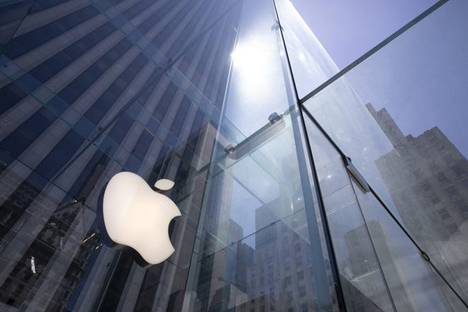 In this June 16, 2020 file photo, the sun is reflected on Apple's Fifth Avenue store in New York. Apple is the first U.S. company to boast a market value of $2 trillion, just two years after it became the first to reach $1 trillion.  (AP Photo/Mark Lennihan, File)