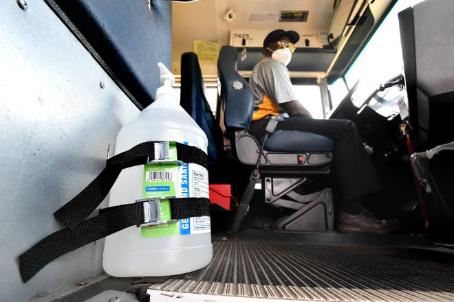 A large bottle of hand sanitizer will be available for students as they enter and leave the school buses that serve Duval County Public Schools.