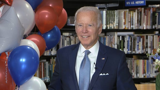 In this image from video, Democratic presidential candidate former Vice President Joe Biden smiles after the roll call vote during the second night of the Democratic National Convention on Tuesday, Aug. 18, 2020. (Democratic National Convention via AP)