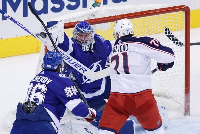 Tampa Bay Lightning goaltender Andrei Vasilevskiy (88) makes a stop on Columbus Blue Jackets left wing Nick Foligno (71) during the second period of an NHL Eastern Conference Stanley Cup first round playoff game in Toronto on Wednesday.