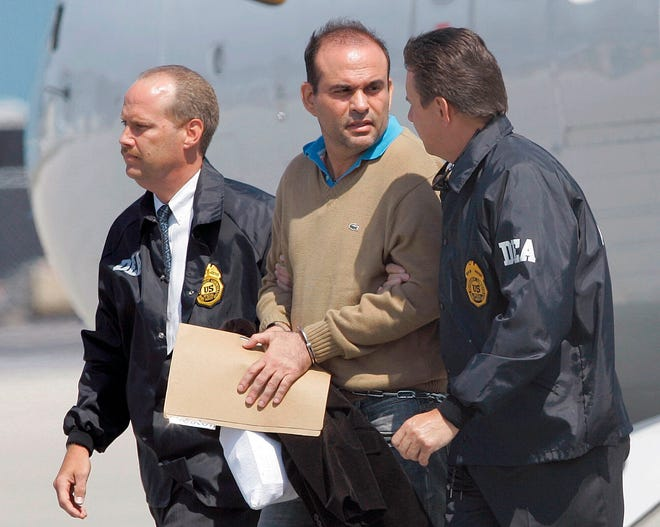 Colombian paramilitary warlord Salvatore Mancuso is escorted by U.S. DEA agents upon his arrival to Opa-locka in May 2008. A legal battle is quietly brewing in the U.S. in 2020 over Colombia's request that this former paramilitary warlord be sent home after completing his drug sentence in the U.S.