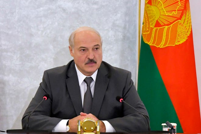 Belarusian President Alexander Lukashenko chairs a Security Council meeting in Minsk, Belarus, on Wednesday. Authorities in Belarus on Wednesday resumed detentions of protesters who keep taking to the streets to demand the resignation of authoritarian Lukashenko, as opposition leaders ratchet up pressure on the government by forming a coordination council to push for for a new election.
