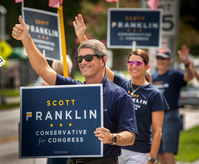 Lakeland City Commissioner Scott Franklin, a Republican candidate for U.S. Congressional District 15, campaigns Tuesday in Lakeland.