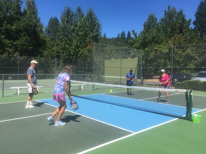 People enjoy the dedicated pickleball court near Mount Shasta Resort.