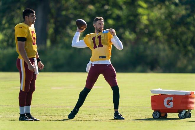 Washington quarterback Alex Smith (11) throws during Tuesday's practice in Ashburn, Va., while teammate Steven Montez looks on. [AP Photo/Alex Brandon]