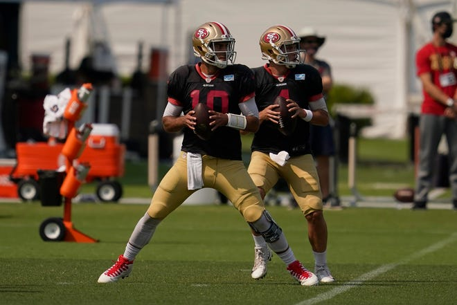 San Francisco 49ers quarterbacks Jimmy Garoppolo (10) and Nick Mullens go through a drill during Tuesday's practice in Santa Clara, Calif. [AP Photo/Jeff Chiu]