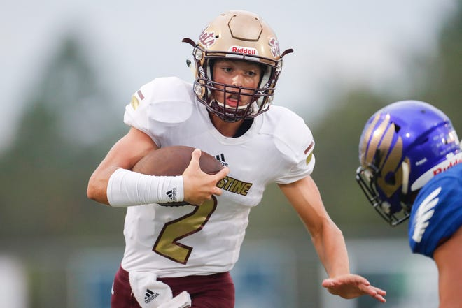 St. Augustine quarterback Sammy Edwards tries to find daylight during the first quarter of an Aug. 30, 2019 football game against Menendez.