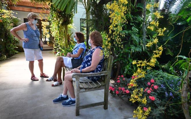 Madeline Wachter of Sarasota, left, talks with her friend Jeannie Parker, center, and sister Carolyn Walker outside the tropical conservatory at Selby Gardens on May 27, 2020. The city of Sarasota has extended its mandatory mask ordinance for another 60 days.