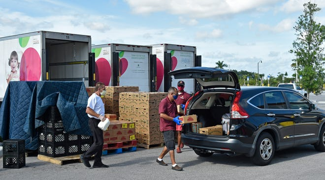All Faiths Food Bank distributes food in North Port in May to help residents impacted by COVID-19. All Faiths hopes its holiday food campaign can provide 9,000 turkeys for families who are struggling during the holidays.