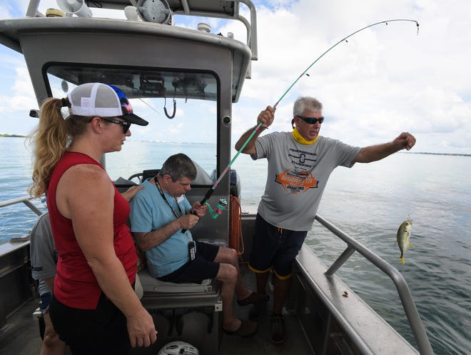 An angler catching a tagged red fish for the Star Tournament may be eligible for a choice of a boat, motor, trailer rig worth up to $80,000. But you must register to be eligible.