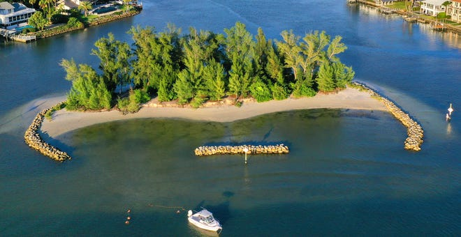 Snake Island, seen here from the west, will close for 75 days, starting in mid-September, so the West Coast Inland Navigation District can dredge Lyons Bay and place sand and rock on the island to build up the western shore.