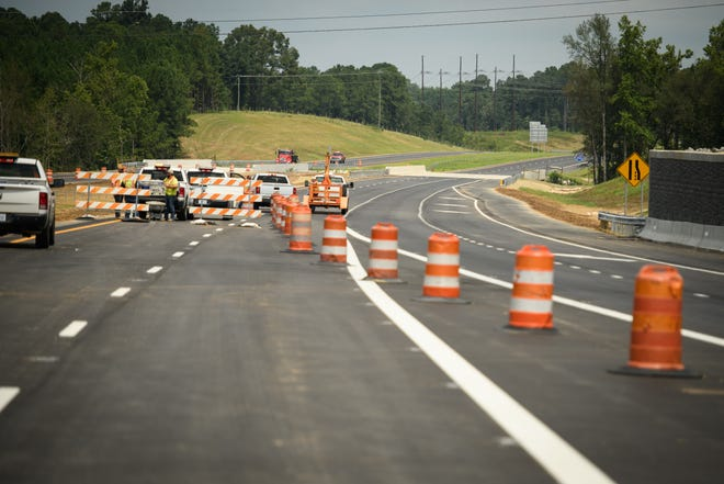 Crews prepare to open a 2.7-mile segment of the Interstate 295 Fayetteville Outer Loop on Aug. 19.