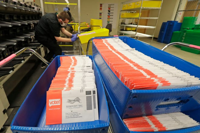 Vote-by-mail ballots are shown in sorting trays. [AP Photo/Ted S. Warren, File]