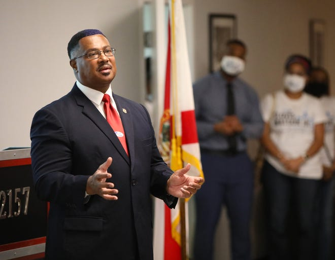 Clovis Watson, Jr., elected Alachua County sheriff, talks about the need to bring back trust in the department as he makes his victory speech at the Firefighters Union Hall in Gainesville on Tuesday night.  Watson defeated Sadie Darnell, who has been sheriff since 2006.