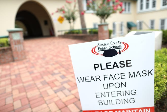 A sign outside the Alachua County school district headquarters in downtown Gainesville. [The Gainesville Sun, File]