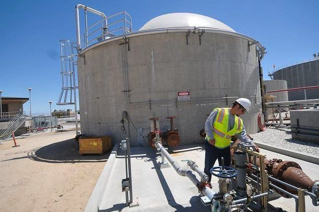 A Victor Valley Wastewater Reclamation Authority worker inspects the facility in this undated photo.