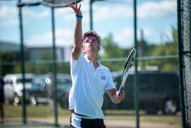 Lakeview senior Cole Einhardt serves the ball to Gull Lake senior Jon McFee during a singles match on Wednesday, Aug. 19, 2020 at Lakeview High School in Battle Creek, Mich.