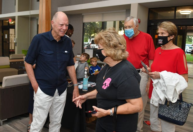 U.S. Rep. Bill Posey chats with Helen Voltz at his victory party Tuesday night at the Holiday Inn Melbourne-Viera Conference Center. Posey defeated Republican challenger Scott Caine in the 8th Congressional District Republican primary.