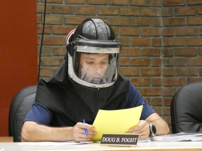 Doug Foght, an independent representing the city's Third Ward, wears a mask during a Bucyrus City Council meeting on Tuesday, Aug. 18, 2020. Masks were required in all city buildings because of the COVID-19 pandemic.