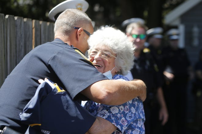 Mimi has presented over 400 flags to Cincinnati police officers over the past 12 years. On Wednesday, the department presented her a flag of her own.