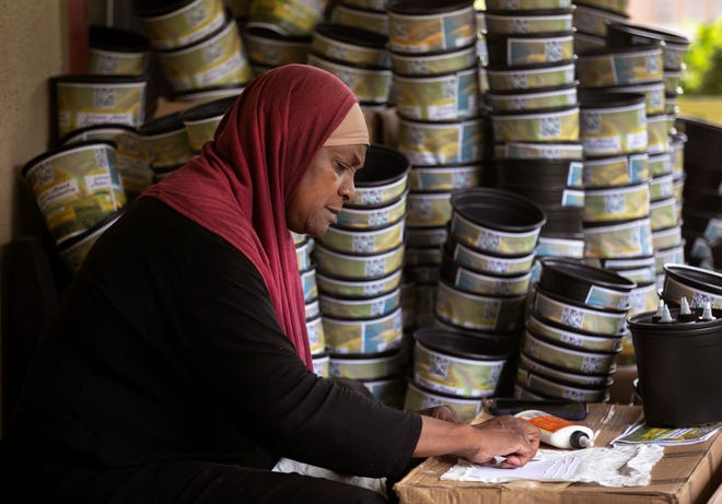"""Rukiye Abdul-Mutakallim, surrounded by 5,000 mini protest pots, as she calls them, plans a silent protest to end violence, racism and fascism along Third Street in front of the National Underground Railroad Freedom Center, beginning Monday, Aug. 24.  On each pot is the name of her son, Suliman Ahmad Abdul-Mutakallim, who was gunned in 2015 as he walked home from White Castle in South Cumminsville. She doesn't want any mother to go through what she's been through. She said, """"It has to stop."""""""
