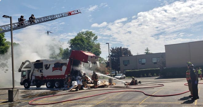 Cincinnati firefighters put out a fire on a CNG fueled Rumpke track in Oakley on Monday