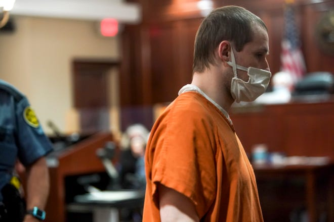 Jordan Hazel, having admitted guilt to the murder of his family, exits the court room at Montgomery County Courthouse in Clarksville, Tenn., on Tuesday, Aug. 18, 2020.