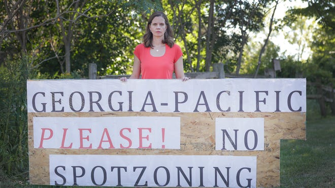 """Town of Lawrence resident Kim Sullivan and her subdivision neighbors are fighting a rezoning request that would allow Georgia-Pacific LLC to build a 1.1 million-square-foot warehouse for paper products. """"This is a neighborhood,"""" she said. """"It doesn't belong here."""""""