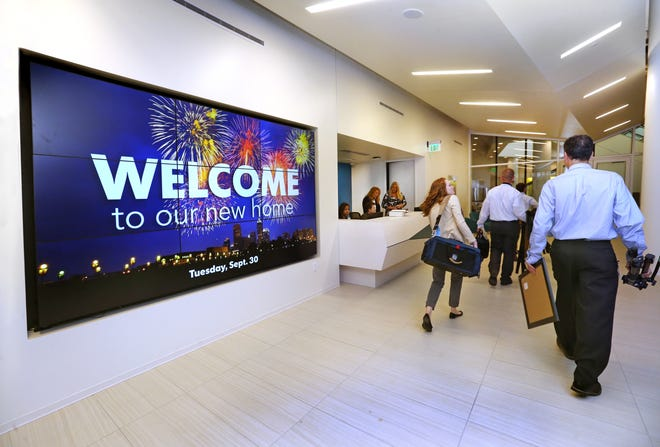 Indianapolis Star employees walk through the Indianapolis Star lobby in the new offices in the Circle Centre Mall in Indianapolis on Tuesday, September 30, 2014. The Star moved from its 107-year-old building to the new offices, in former Nordstrom retail space in the mall, this week.