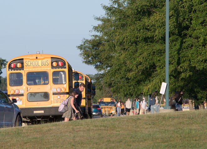 Students return to classes, the first opening day in the area, at Howell High School Wednesday, Aug. 19, 2020.