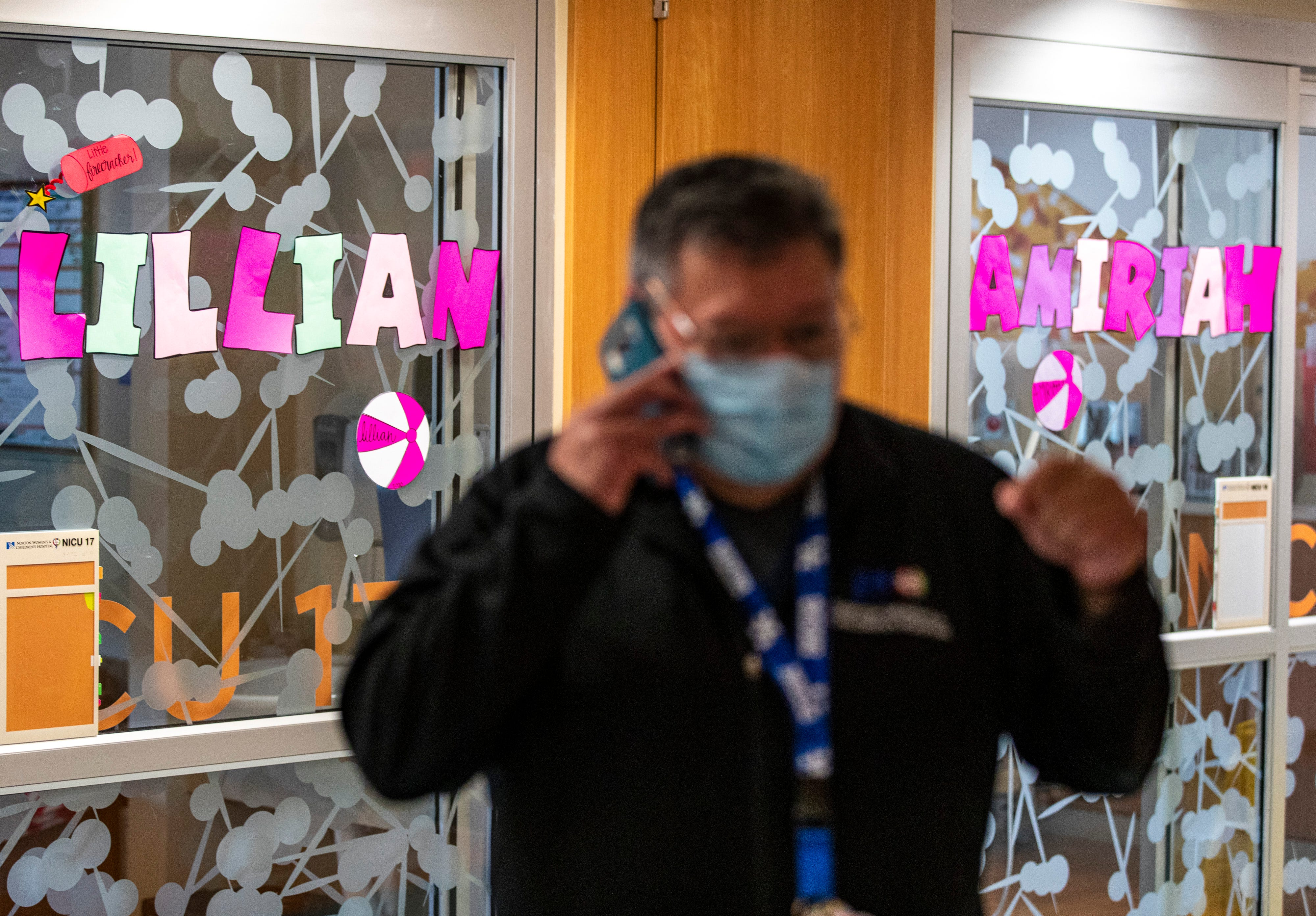 Chaplain Adam Ruiz takes a phone call while working in the ICU July 29 at Norton Women's and Children's Hospital.