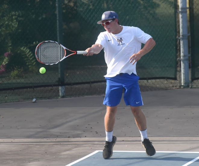 Mountain Home's Clayton Jones returns a shot during action against Conway on Tuesday.