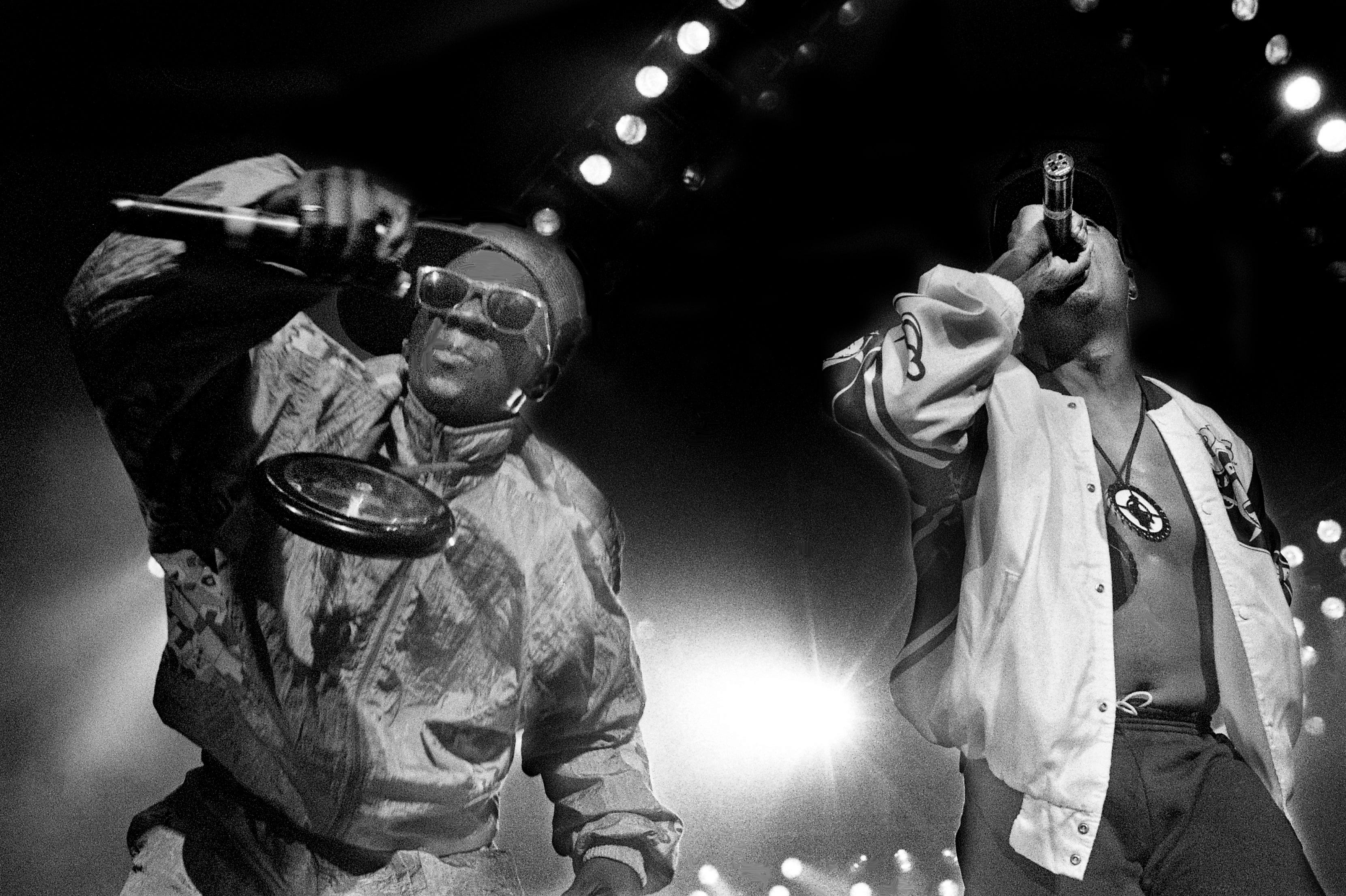 Public Enemy's Flavor Flav, left, and Chuck D perform for nearly 5,000 teens at Starwood Amphitheatre on Aug. 8, 1990.
