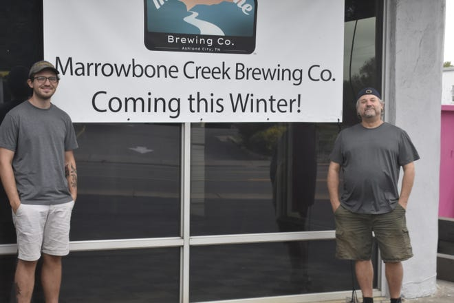 Ryan Jensen (left), Chris Morris (right) and Julie Morris are opening the Marrowbone Creek Brewing Co. at 240 S. Main St. in Ashland City.