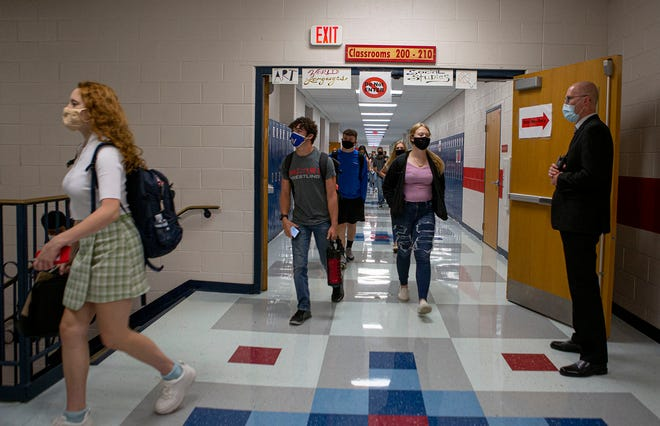 Licking Valley principal, Wes Weaver stands in the hallway to help direct foot traffic on the first day of school for 2020-21. All hallways and stairways were made one-way to help with social distancing measures. Students and teachers were also all wearing masks and desks were spaced further apart.