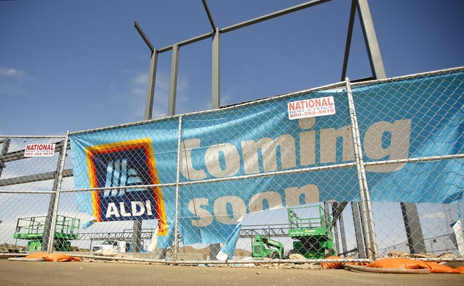 Construction of an Aldi supermarket takes place at a new shopping center, Sunrise Promenade, in Peoria on Aug. 17, 2020.