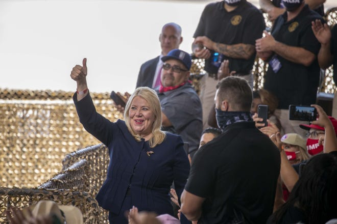 President Donald Trump recognizes Republican Rep. Debbie Lesko during a rally at the Joe Foss Hangar in Yuma on Aug. 18, 2020.