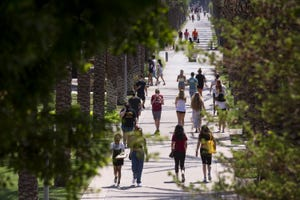Students walk on campus the day before school opens on Aug. 19, 2020, at Arizona State University in Tempe.