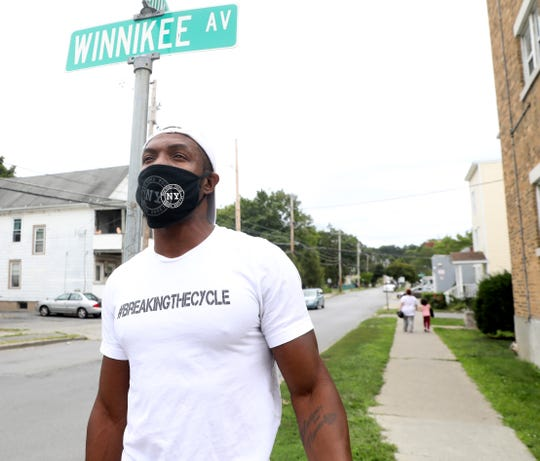 James Stanfield walks in his old neighborhood along Winnikee Avenue in the City of Poughkeepsie on August 19, 2020. Stanfileld, who grew up in the neighborhood and got involved in criminal activity which ultimately led to going to prison. He has started #breakingthecycle to help inner city youths from going down a similar path.