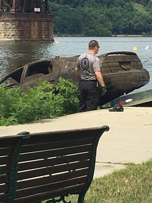 A vehicle is pulled from the Hudson River by New York State Police in the City of Poughkeepsie as seen on Wednesday, Aug. 19, 2020.