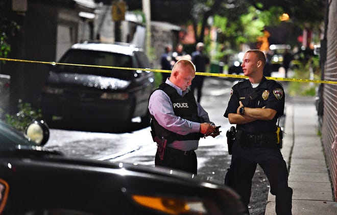 York City Police Chief Troy Bankert, left, and Officer Clayton Swartz as officials investigate a fatal shooting reported near the corner of South West and West Princess Streets in York City, Wednesday, Sept. 26, 2018. York City Mayor Michael Helfrich said the shooting resulted in the death of an adult male and an injured juvenile who was transported to York Hospital. Dawn J. Sagert photo