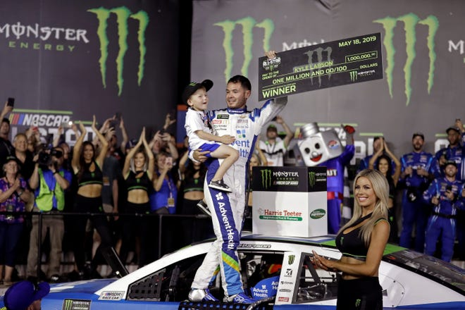FILE - In this Saturday, May 18, 2019, file photo, Kyle Larson celebrates in Victory Lane after winning the NASCAR All-Star Race at Charlotte Motor Speedway in Concord, N.C. Larson has been working behind the scenes to educate himself on racial issues since his firing from NASCAR for using a racial slur. (AP Photo/Chuck Burton, File)