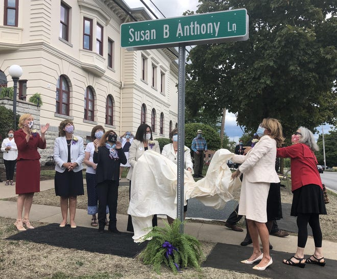 A street sign bearing the name Susan B. Anthony Lane is unveiled Tuesday outside the Ontario County Courthouse where famed Rochester suffragist Susan B. Anthony was tried and convicted for voting.
